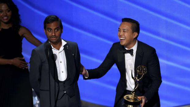Ansari and Yang accept the award for Outstanding Writing For a Comedy Series at the 68th Primetime Emmy Awards in Los Angeles